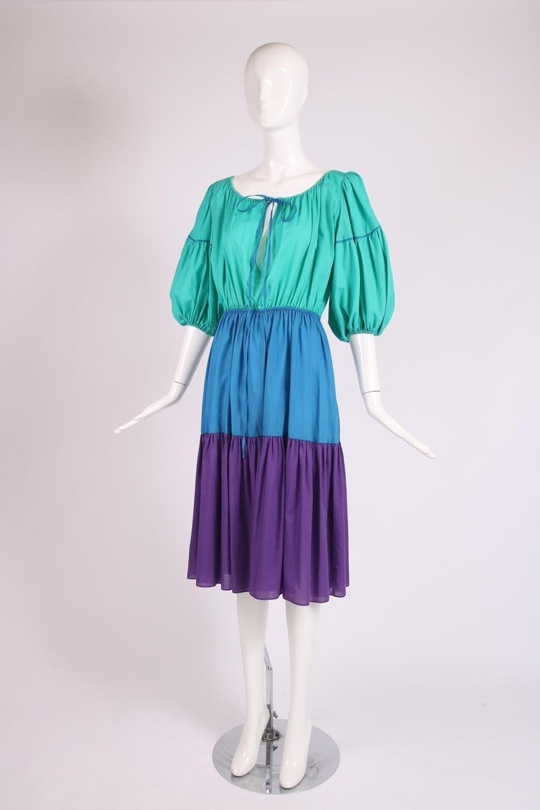 Yves Saint Laurent cotton colorblocked day dress with balloon sleeves, elastic waist, neck ties and tiered skirt. In excellent condition - no size tag, please consult measurements.  Bust - 36