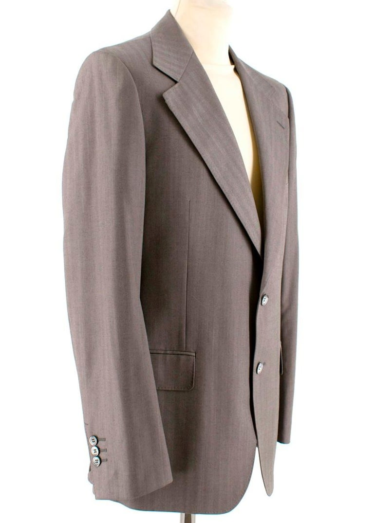 Yves Saint Laurent Grey Striped Wool Suit  Jacket - Two front pockets and one breast pocket - One internal button up pocket, one internal open pocket and small pen pocket - Two button closure - Three button sleeve closure  Trousers - Flap button