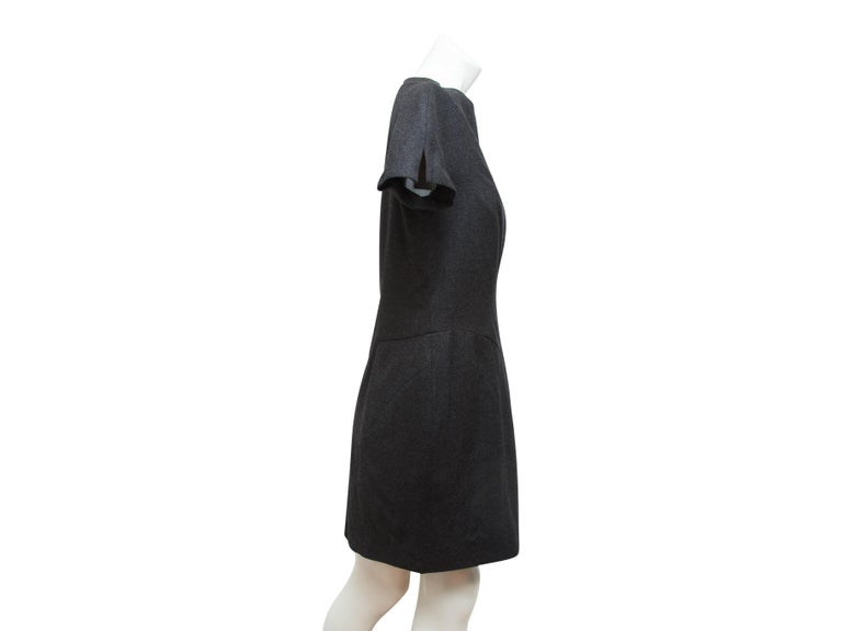 Product details:  Grey wool sheath dress by Yves Saint Laurent.  Crewneck.  Short sleeves.  Princess seams create a flattering silhouette.  Concealed back zip closure.  Label size FR 40.  36