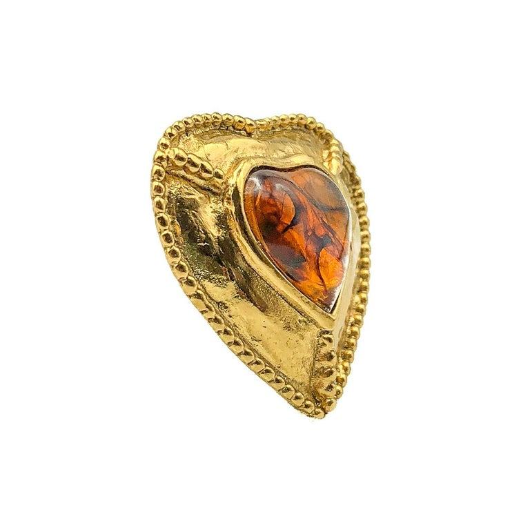 A wonderful Yves Saint Laurent Heart Pendant. Crafted in gold plated metal and set with a large amber style resin heart. The heart, the symbol of the House of Yves Saint Laurent since the 1960s is the most perfect expression of YSL style and design.