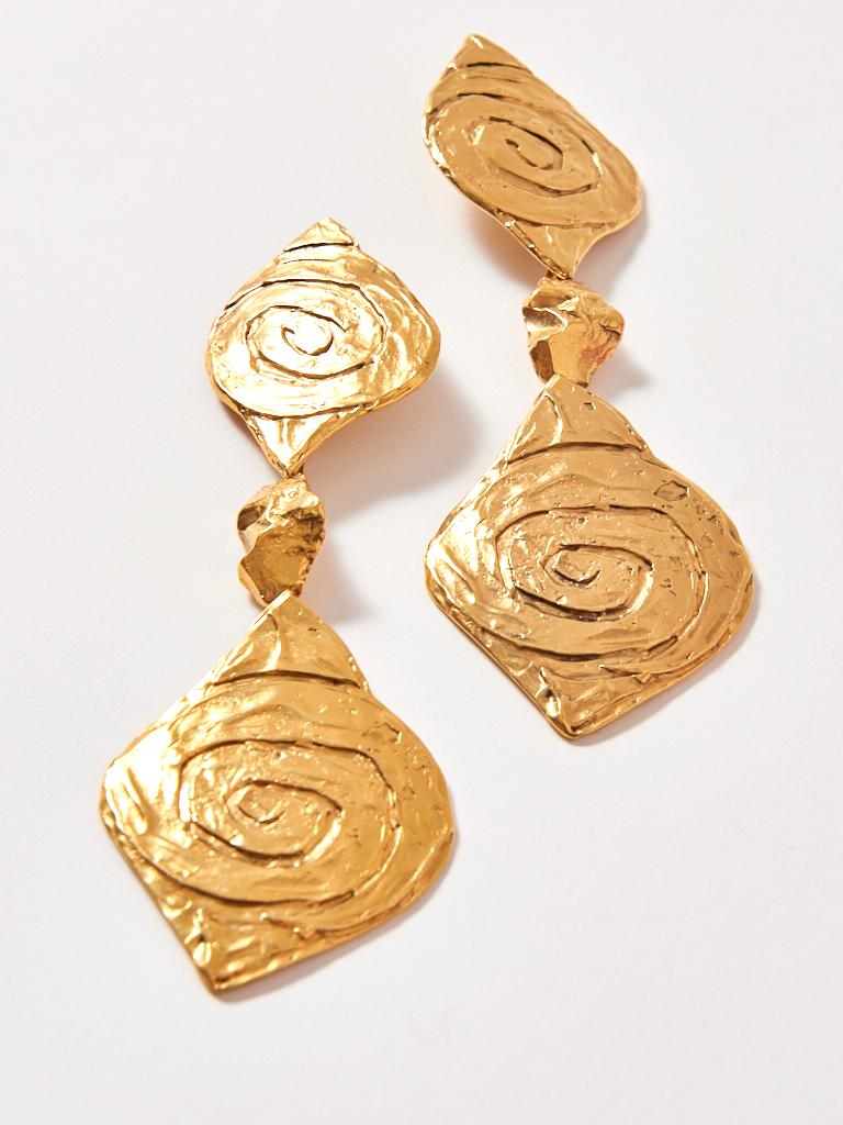 Yves Saint Laurent, gold tone, white metal, clip on, drop earrings having engraved spiral detail. These earrings are super long and hit the shoulders.