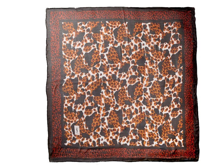 Yves Saint Laurent, Rive Gauche, large size, silk chiffon leopard print scarf, having mixed leopard patterns on the interior and borders of the scarf. Dominant tones are deep umber, black and pale grey.