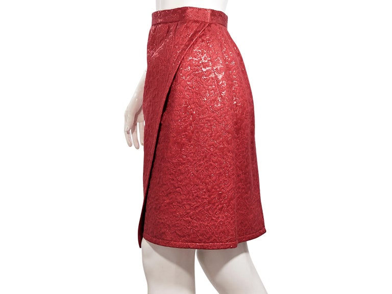 Product details:  Vintage metallic red brocade wrap skirt by Yves Saint Laurent.  Circa the 1970s/1980s.  Banded waist.  Concealed hook closure.  Label size FR 40.  26