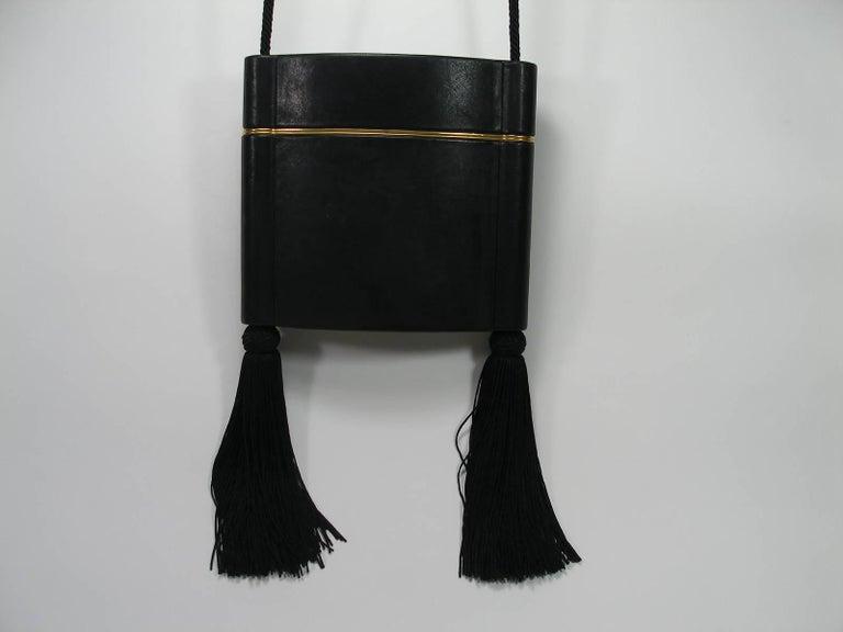 Black Yves Saint Laurent Minaudière à Pompons cuir et métal doré  For Sale