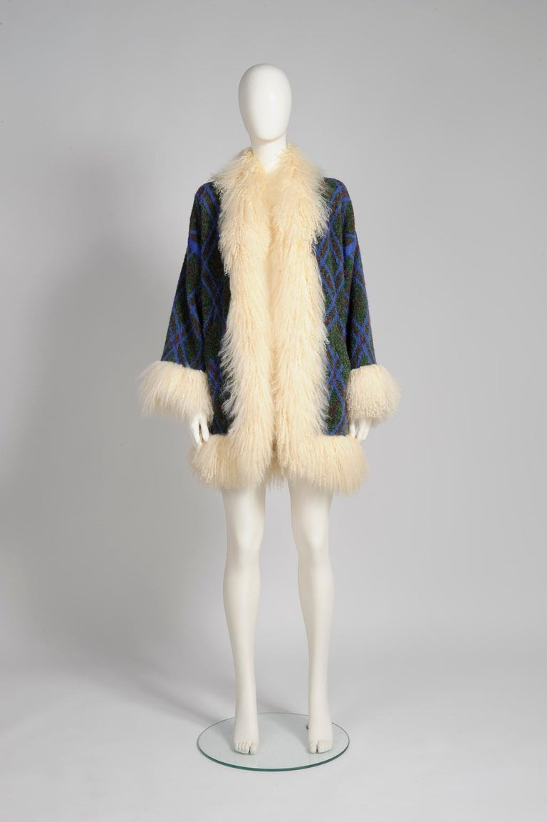 Unusual stunning late 70s YSL wool and genuine fuzzy Mongolian sheep fur cardigan coat. Unlined, the coat features two pockets. Raglan sleeves. No fastening. Despite the coat being labelled a French size 36 (US 2-4), it will accomodate a large range