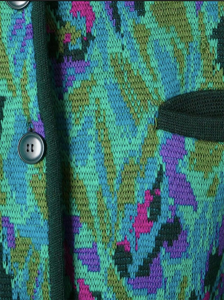 Yves Saint Laurent multicolour wool jacquard long cardigan featuring a round neck, a front button fastening, long sleeves, a chest pocket and two front pockets.  100% wool In good vintage condition. Made in France.  Estimated size 40fr/US8/UK12 We