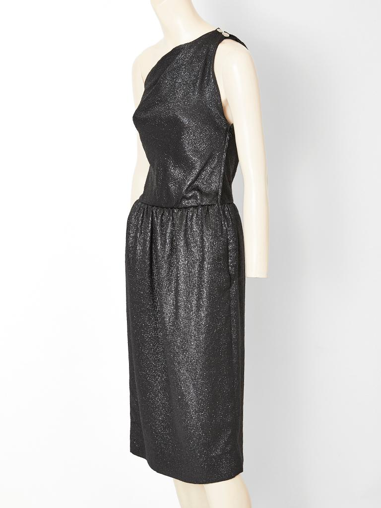 Yves Saint Laurent, Rive Gauche, black metallic, silk cloqué, one shoulder cocktail dress having a subtle shimmer, fitted bodice, a gathered skirt,  and a side zipper  closure.
