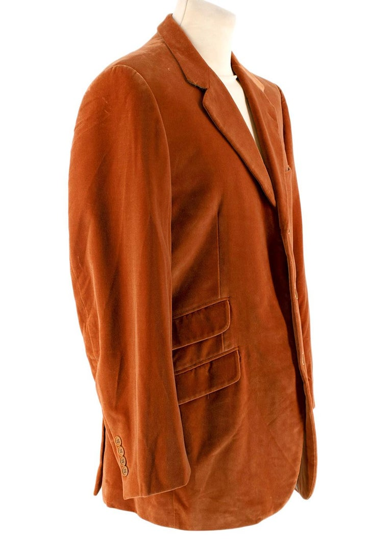 Yves Saint Laurent Orange Cotton Velvet Single Breasted Suit  -Made of soft luxurious cotton velvet  -Warm orange hue  -Single breasted classic cut  Jacket: -4 pockets to the front  -4 insere pockets  -Fully lined  -Button fastening  to the front