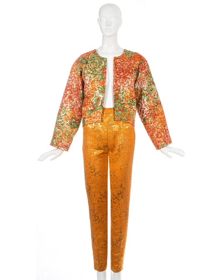 Yves Saint Laurent orange metallic brocade evening pant suit. Jacket has a boxy fit with no closures and green silk lining. High waisted slim fit pants.  Fall-Winter 1989