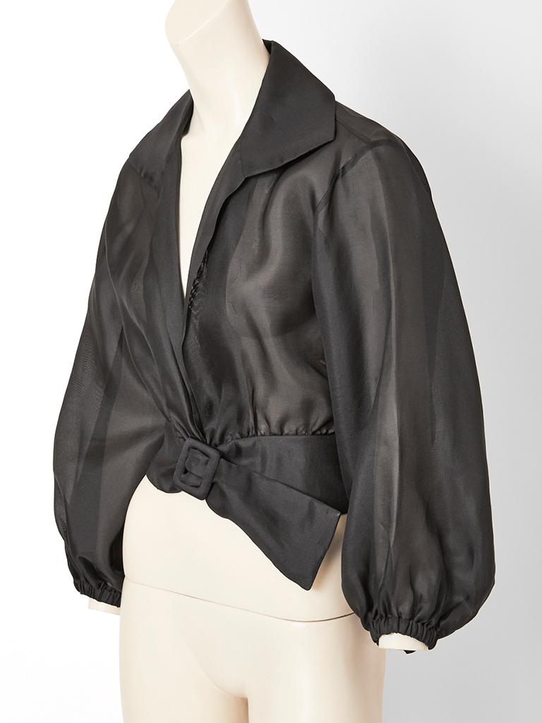 Yves Saint Laurent,  rive gauche, black, sheer, organza, blouson, having a stand up  pointed collar with a deep open neckline. The blouse ends at the waist having an attached self, wide belt, sheer, balloon sleeves with elastic at the wrists.