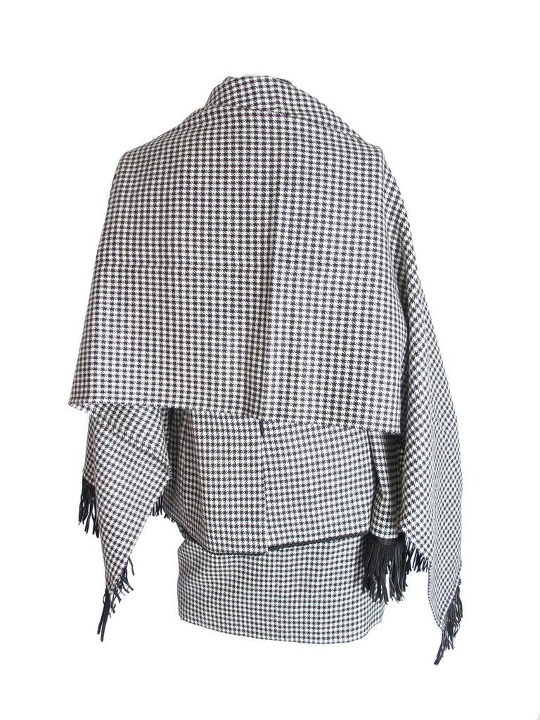 Yves Saint Laurent Rive Gauche 4 piece wool herringbone suit. Pants, skirt, jacket and wrap. Condition: Excellent. Size 40