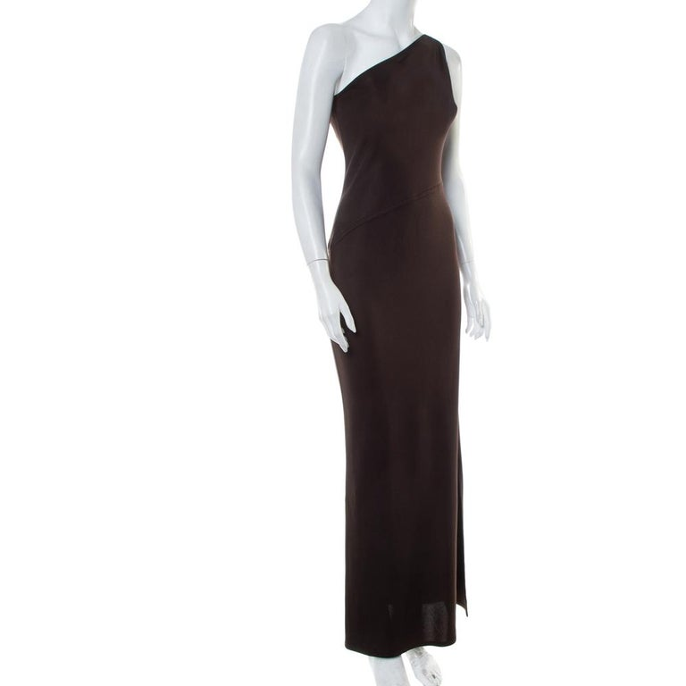 This timeless dress from the house of Yves Saint Laurent is a staple that can be dressed up or down. An appealing number like this brown-hued maxi dress requires no effort to look stylish. It has a one-shoulder style, a fitted silhouette, zip