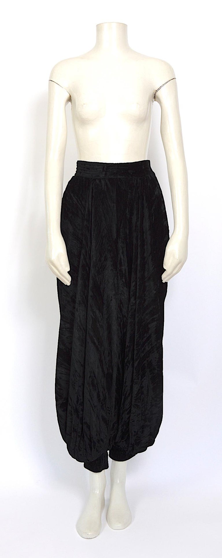 """These documented rare 1970s Loulou de la Falaise style Yves Saint Laurent high-waisted crushed velvet harem pants with pleating and elasticized cuffs are from the designer's famous """"Rive Gauche"""" ready-to-wear line. Made in France. They do up on the"""