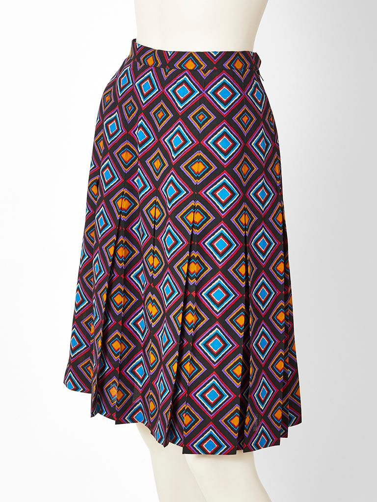 Yves Saint Laurent, Rive Gauche, multi tone, wool challis, geometric pattern skirt. Skirt has box pleats that start at the hip. Pleats are stitched down at the waist and hip. Designer: