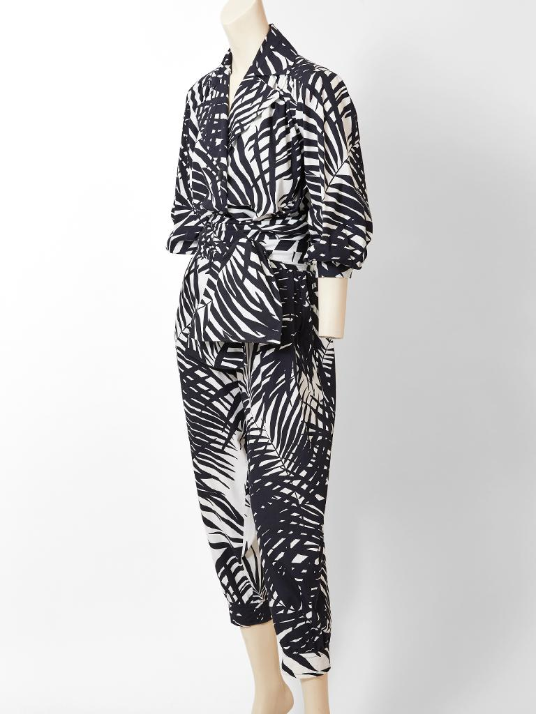 Yves Saint Laurent, rive Gauche, black and white, cotton, graphic, palm leaf pattern blouse and jogger pant ensemble. Blouse has an oversize, notched collar with a single black button closure  and a wide sash. Pant is a jogger shape that tapers at