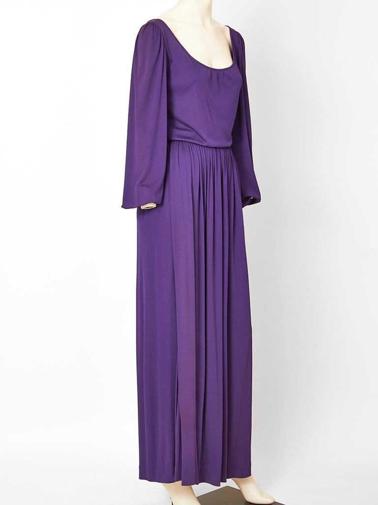 Yves Saint Laurent, Rive Gauche, purple, classic, matte jersey, gown having a scoop neckline, full sleeves that have elastic at the wrist, and a gathered long skirt. Bodice drapes slightly at the waist. C. 1970's.
