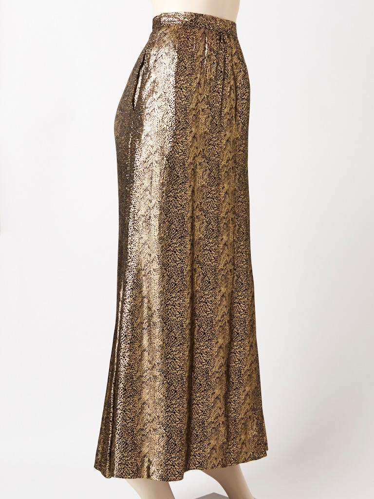 Yves Saint Laurent, Rive gauche, long, evening skirt, in a reptile pattern gold lame , having a slightly gathered waist, and hidden side pockets at the hip.