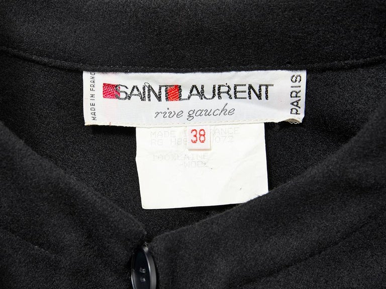 Yves Saint Laurent, Rive Gauche, black wool, maxi cape with a single button closure at the neck.