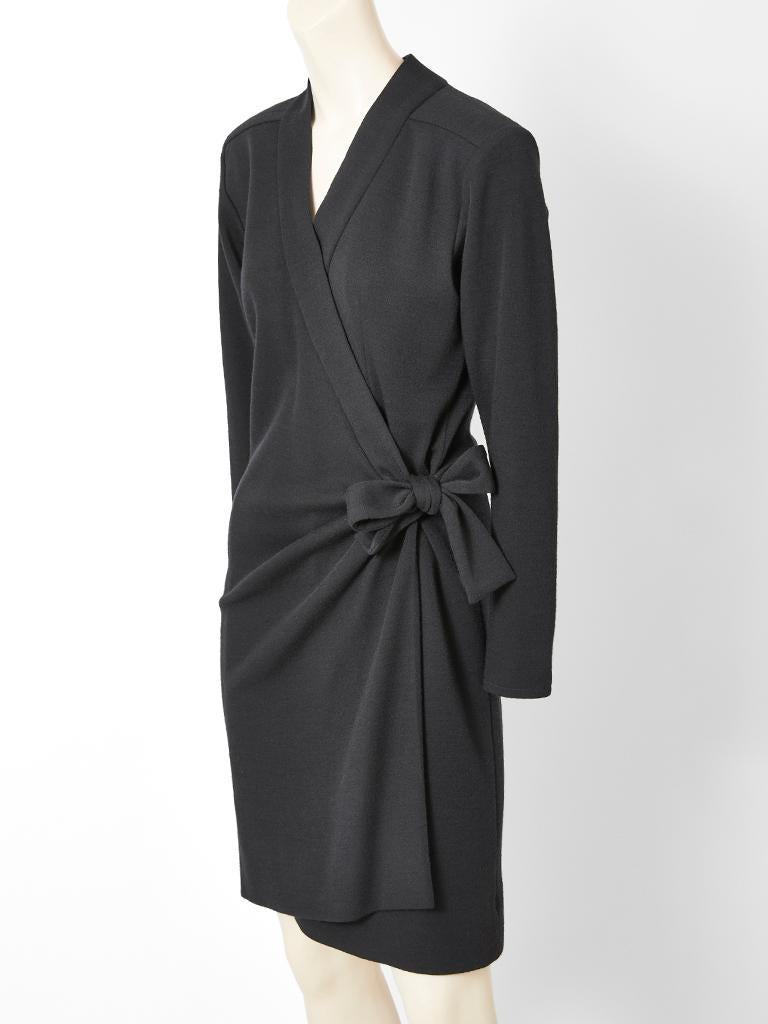 Yves Saint Laurent, Rive Gauche, black, wool jersey knit, V neck, long sleeve, wrap dress having soft gathering at the hip with a tie detail that can be made into a bow.