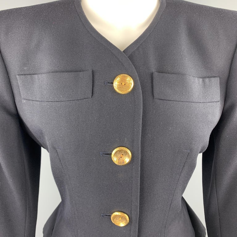 Vintage YVES SAINT LAURENT Rive Gauche blazer comes in navy wool with a collarless V neck, padded shoulders, gold tone buttons. Made in France.  Excellent Pre-Owned Condition. Marked: FR 38  Measurements:  Shoulder: 16 in. Bust: 38 in. Sleeve: 23