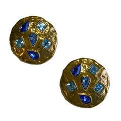 YVES SAINT LAURENT Round clip-on Earrings in Gilded metal and Blue Rhinestones