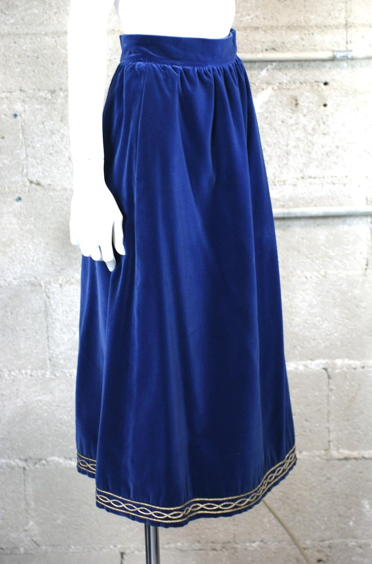 Yves Saint Laurent Russian Collection Skirt in a soft, silky marine blue cotton/rayon blend. Simply constructed with gathered waist and gold soutache embroidery along hem. Fully lined. Size 36 Vintage. YSL Rive Gauche Waist 24