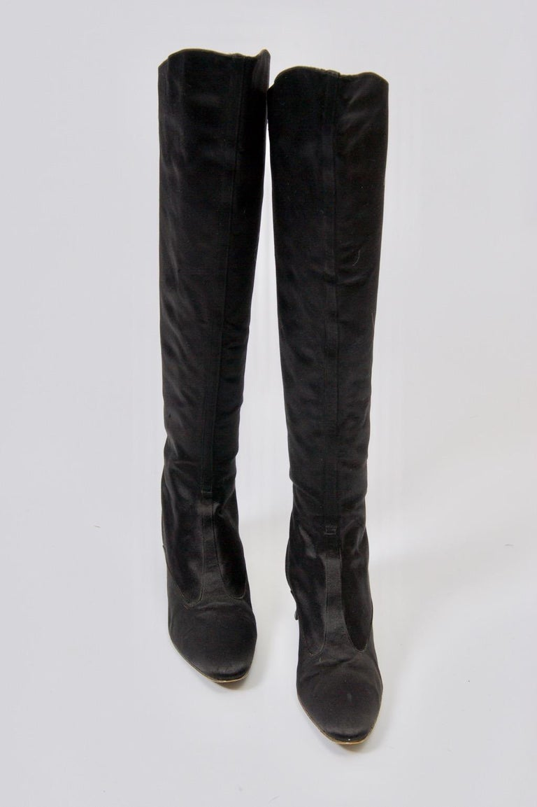 Saint Laurent black satin knee-high boots with low modified Louis heel. Gold leather lining. Marked on leather sole size 7 1/2M.