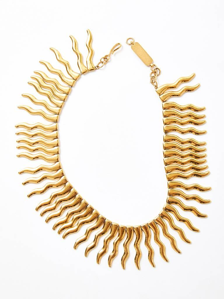 Yves Saint Laurent, signed and numbered gold tone base metal, collar necklace having a sunburst theme. Numbered 043/500.