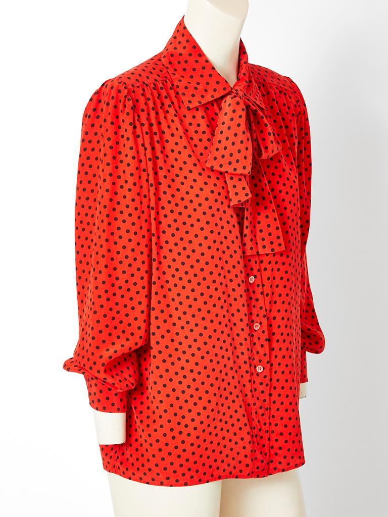 Yves Saint Laurent, Rive Gauche, red, silk crepe, Lavalière blouse having black polka dots, long sleeves and front button closures. Bow can be tied at the neck or worn loosely.