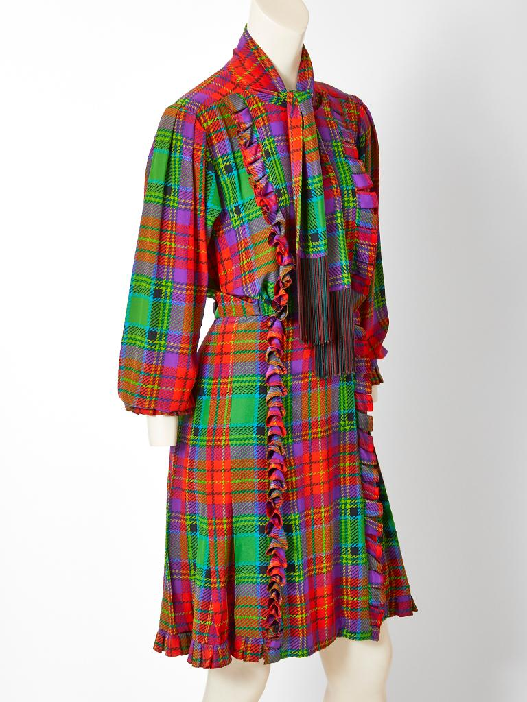 Yves Saint Laurent Rive Gauche, multi tone, silk, tartan plaid, skirt and blouse ensemble. Blouse and skirt both have a vertical ruffle detail. The top has a detachable scarf with a deep fringe. Skirt is like a kilt with a flat front and vertical