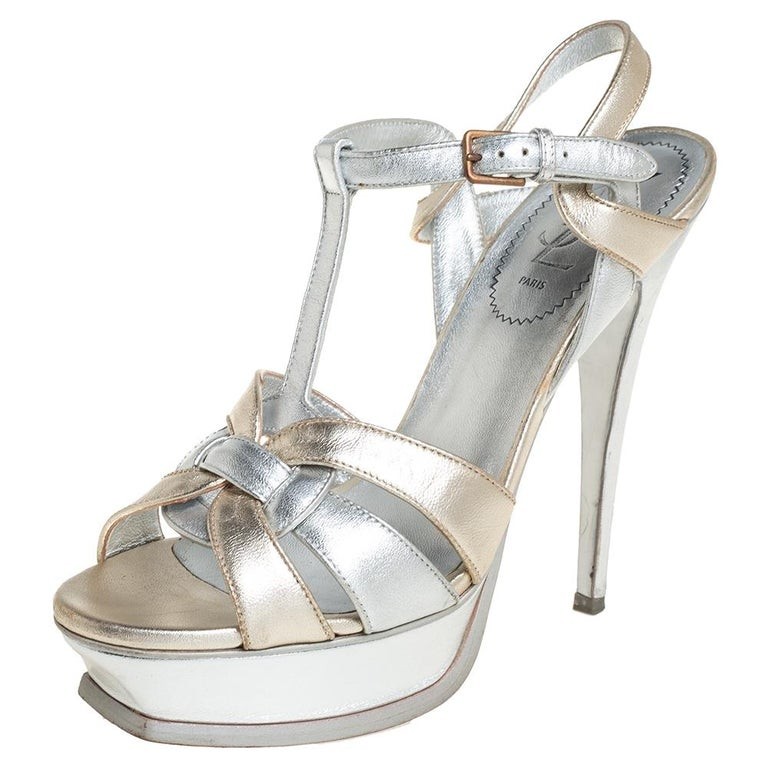 One of the most sought-after designs from Yves Saint Laurent is their Tribute sandals. They are such a craze amongst fashionistas around the world, and it is time you own one yourself. These gold & silver ones are designed with leather straps, ankle