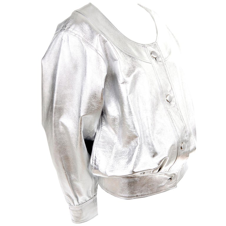 This is an outstanding vintage jacket from Yves Saint Laurent in a beautiful silver leather. This gorgeous YSL jacket has front buttons, oversized sleeves, a scoop neck and it is fully lined.  The jacket is meant to be worn oversized and is labeled