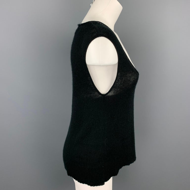 YVES SAINT LAUREN tank top comes in a black knitted cashmere featuring a scoop neck. As-Is. Made in Italy.  Good Pre-Owned Condition. Marked: L  Measurements:  Shoulder: 16 in.  Bust: 34 in.  Length: 22.5 in.
