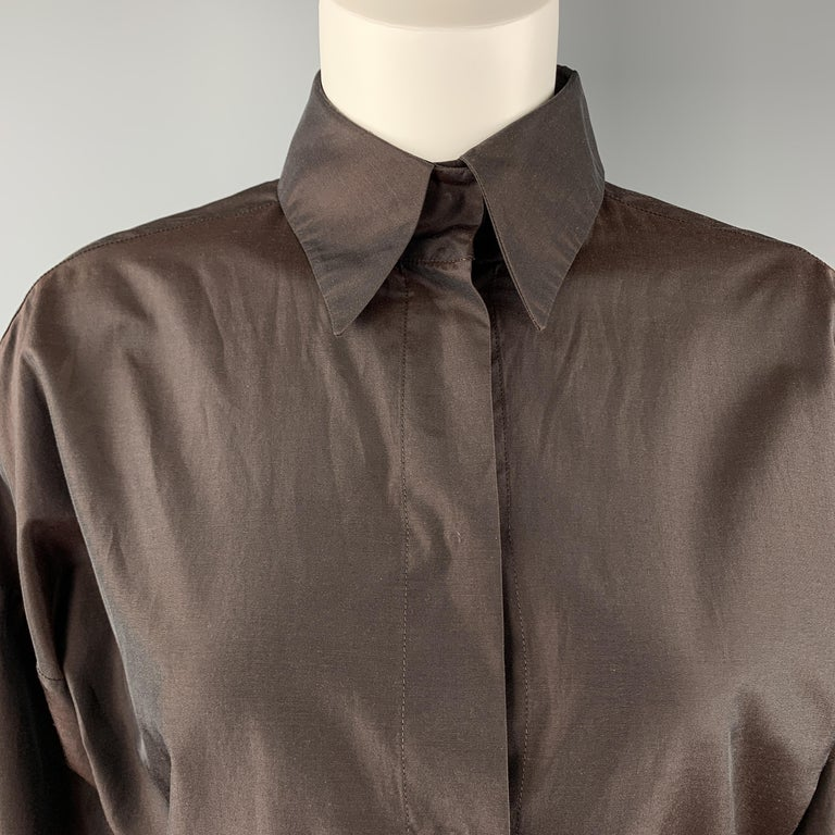 Vintage YVES SAINT LAURENT RIVE GAUCHE blouse comes in brown silk blend taffeta with a pointed collar, drop shoulder, and hidden placket snap up front. Made in France.  Excellent Pre-Owned Condition. Marked: IT 40  Measurements:  Shoulder: 24