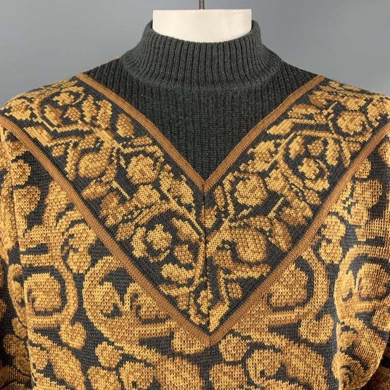Vintage YVES SAINT LAURENT RIVE GAUCHE pullover sweater comes in gray wool with an all over gold baroque pattern and mock neck. Made in France.  Very Good Pre-Owned Condition. Marked: 52  Measurements:  Shoulder: 24 in. Chest: 54 in. Sleeve: 28