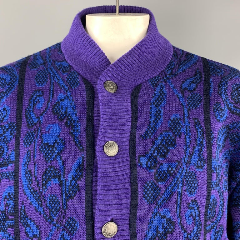 Vintage YVES SAINT LAURENT RIVE GAUCHE cardigan jacket comes in a vibrant purple and blue baroque print wool knit with silver tone embossed button front and quilted liner. Made in France.  Very Good Pre-Owned Condition. Marked: IT