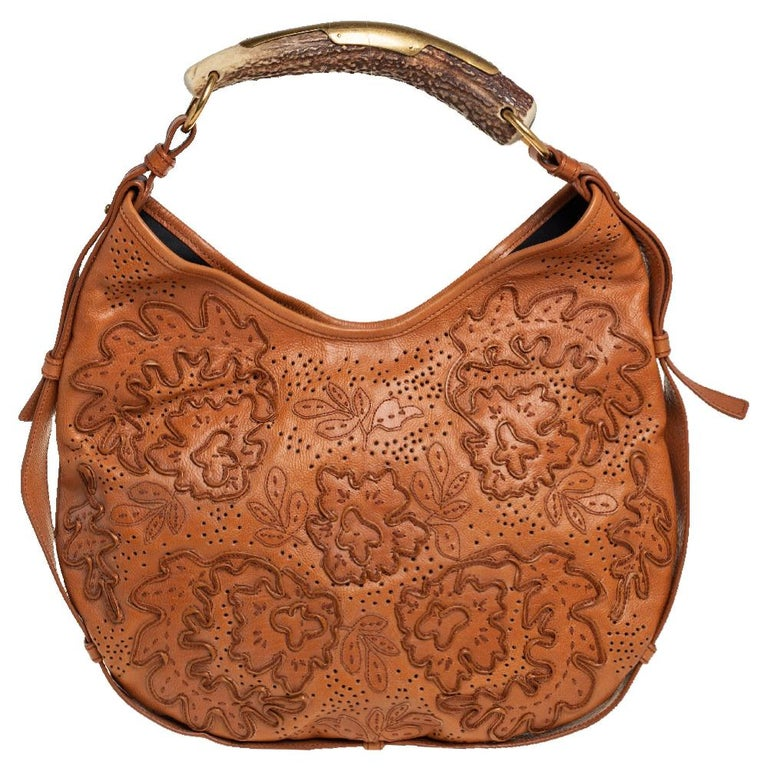 It is indeed rare for one to chance upon a hobo as gorgeous as this one from Yves Saint Laurent. It comes beautifully crafted from embroidered leather and designed with a horn handle and gold-tone hardware. The bag also brings a satin-lined interior