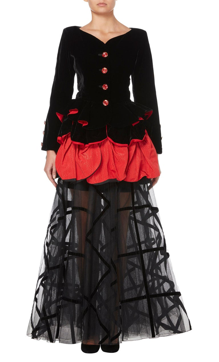 Black and red silk two-piece flared skirt set from Yves Saint Laurent Vintage featuring long sleeves, a button fastening, a frill trim, a flared skirt, a long length and a sheer construction. Please note that vintage items are not new and therefore