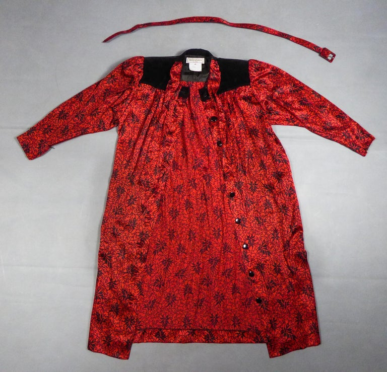 Circa 1990 France  Iconic blouse dress in printed silk satin from the Variation line by Yves Saint Laurent and dating from the 1990s. Beautiful silk satin printed with stylized patterns in illuminations probably from the designer houseStaron in