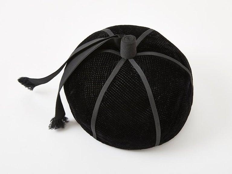 Yves Saint Laurent, black velvet beanie, having black gross grain detail.