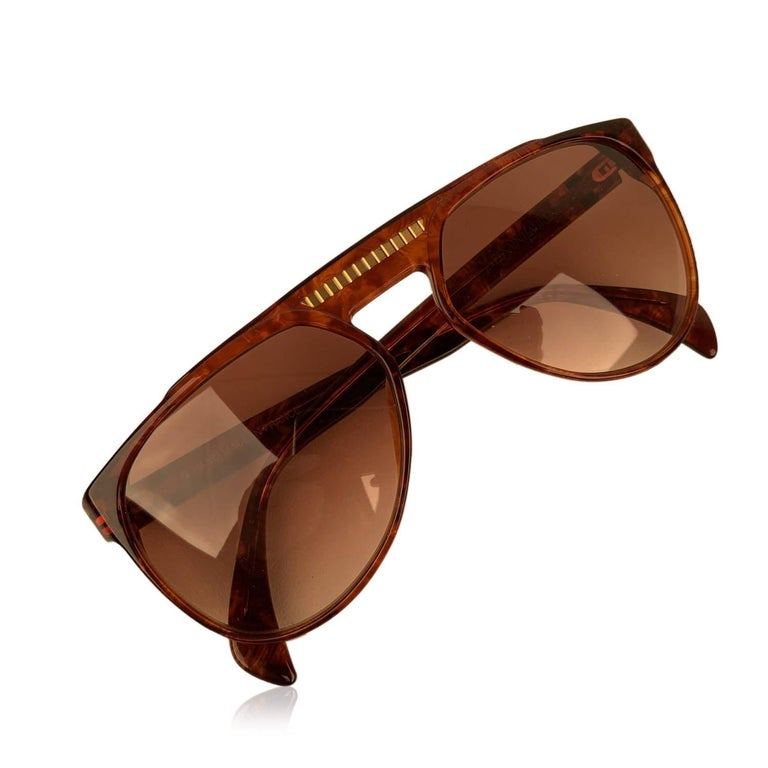MATERIAL: Acetate COLOR: Brown MODEL: 8726 P094 GENDER: Women, Men SIZE: Medium Condition NOS - New Old Stock - Never worn or Used - They will come with a GENERIC Case Measurements TEMPLE MAX. LENGTH: 140 mm EYE / LENS MAX. WIDTH: 57 mm EYE / LENS