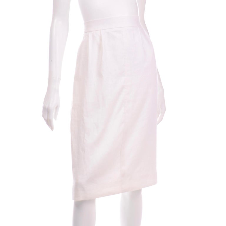 This is a vintage white linen pencil skirt designed by Yves Saint Laurent for the Rive Gauche label. This is a such a great staple piece to add to any modern wardrobe and it is so beautifully made! There functional side pockets and pleats along the