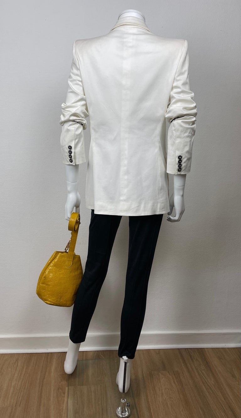 YVES SAINT LAURENT, Made in France, circa 2000's.  YSL white cotton jacket with padded shoulders and larges pockets.  The light on pictures makes it seems shiny but it is not !  Tag size is 42FR but please see measurements bellow, taken flat and