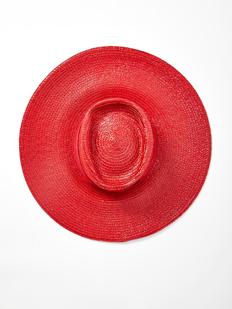 Yves Saint Laurent, wide brim, red lacquered, straw, hat with gross grain ribbon detail at the crown. Width of brim: 5 inches.