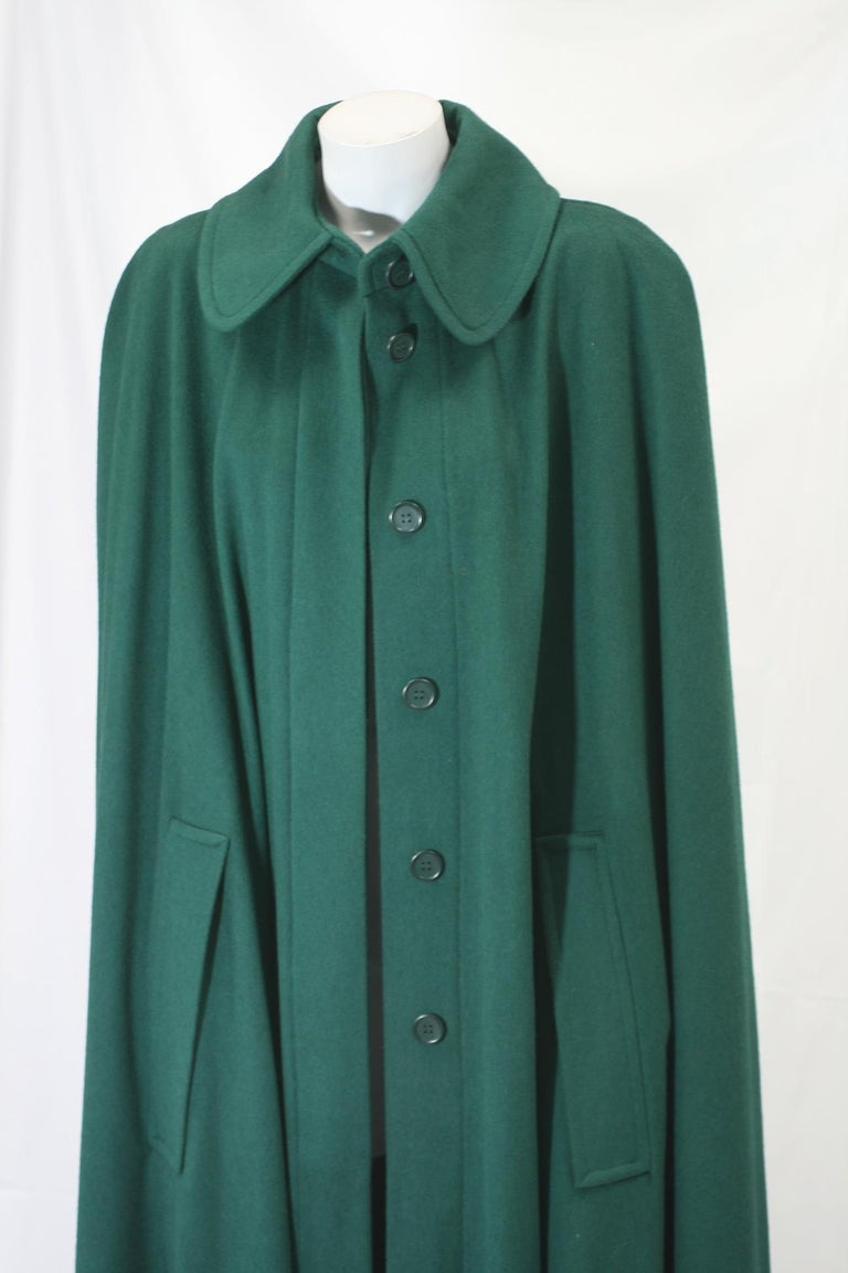 Yves Saint Laurent Wool Melton Cape in a wonderful evergreen wool. Full cut with dramatic huge sweep at hem. 1990's France. Covered button front, with slash access entry for hands. A forever classic.  Excellent condition. 100% Wool Medium Weight