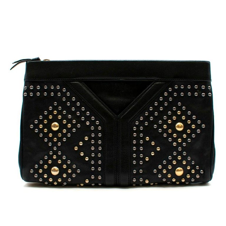 Yves Saint Laurent Y-studded leather clutch  - Black, lightly grained leather  - Gunmetal and gold-tone metal stud embellished  - Y paneled front - Front and back slip pockets  - Zip-fastening centre pocket, internal slip pocket - Black canvas