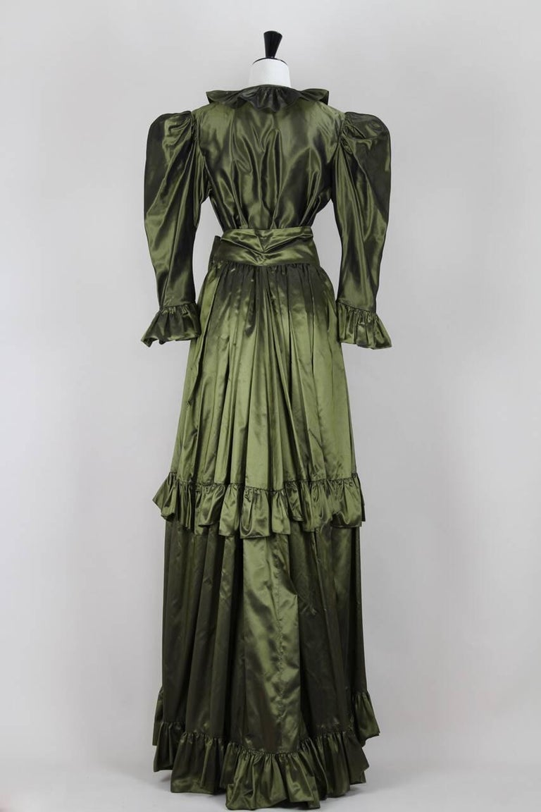 This is an exceptional and collectible iridescent olive green silk taffeta two-piece gown by Yves Saint Laurent from 1978. This Rive Gauche version would have been based on that Haute Couture gowns from the late seventies collection. The ensemble