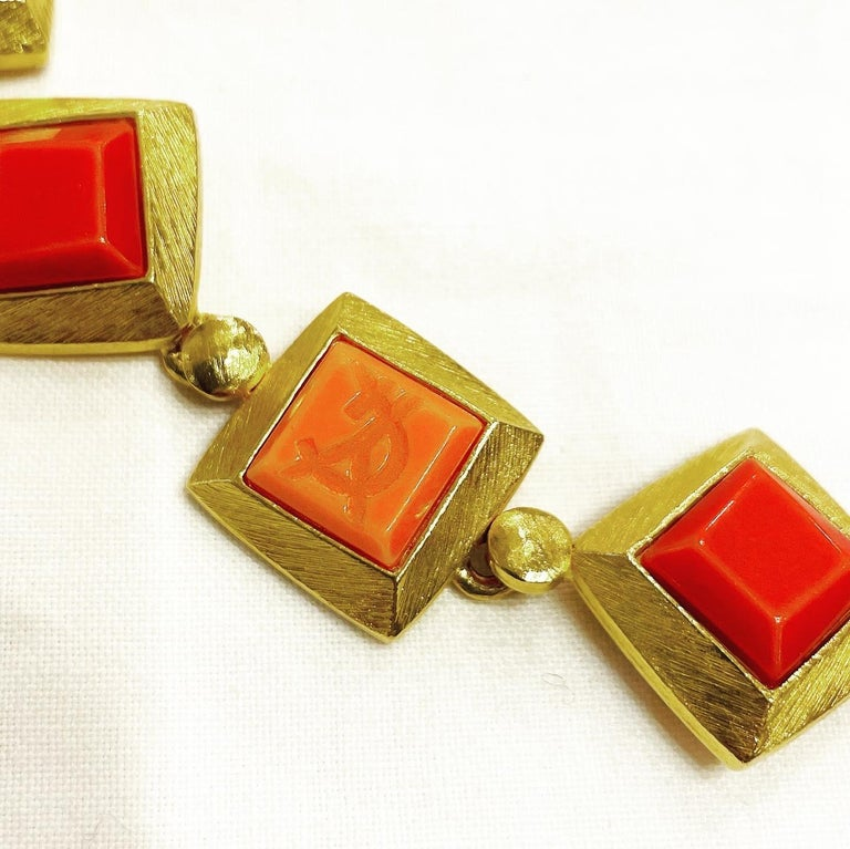 1980s gorgeous vintage YVES SAINT LAURENT square shape orange and red resin choker necklace!  Gilt chain with the YSL logo.  Can really add just that little extra elegance to any outfit!  Great with jeans, and perfect with a dress. You can wear it