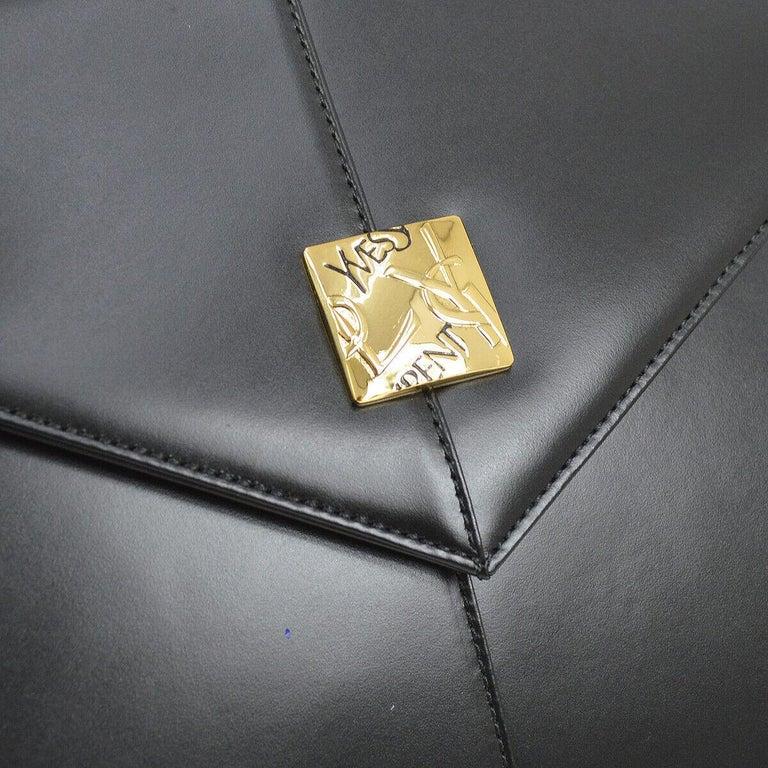 Yves Saint Laurent YSL Black Leather Top Handle Kelly Style Shoulder Satchel Flap  Bag  Leather Gold tone hardware Woven lining Magnetic closure Handle drop 5