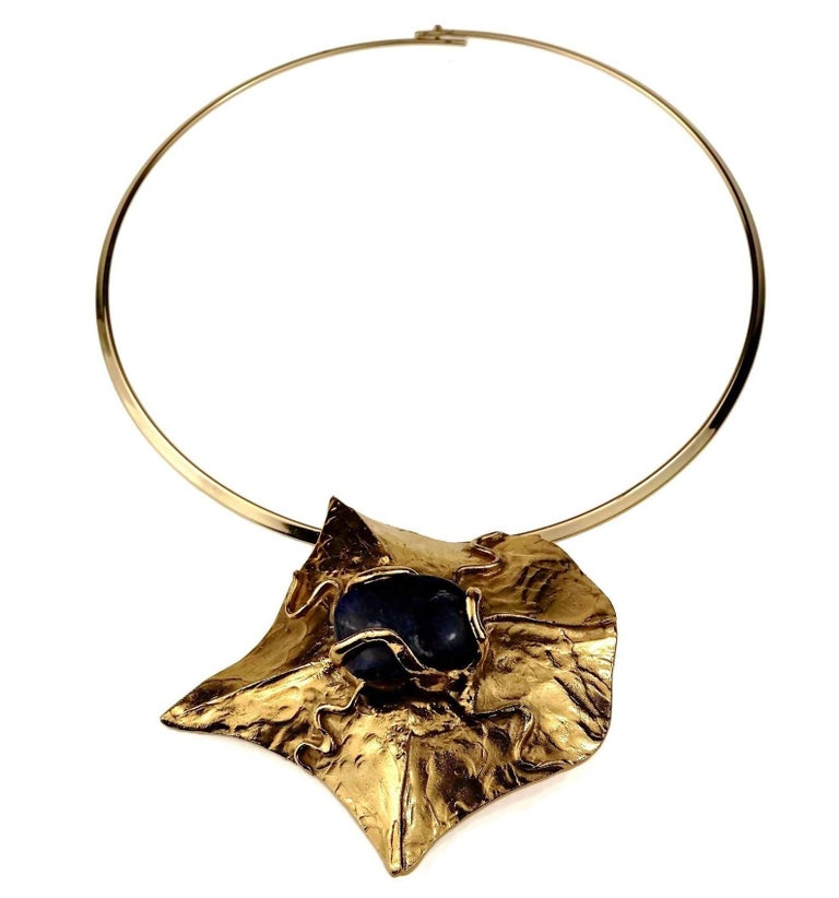 Vintage Unsigned YVES SAINT LAURENT Ysl by Robert Goossens Caged Lapis Lazuli Pendant Necklace  Measurements: Height: 3.27 inches (8.3 cms) Width: 3.42 inches (8.7 cms)  Unsigned piece.  Features: - 100% Authentic Unsigned YVES SAINT LAURENT by